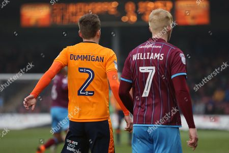 Scunthorpe United forward Luke Williams (7) and Oldham Athletic defender Cameron Dummigan (2) during the EFL Sky Bet League 1 match between Scunthorpe United and Oldham Athletic at Glanford Park, Scunthorpe. Picture by Mick Atkins
