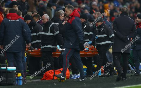 Winston Reid of West Ham United is given oxygen as he is stretchered off
