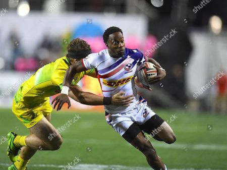 USA player Carlin Isles try to break a tackle in the game USA vs Australia during the USA Sevens Rugby Series at Sam Boyd Stadium, Las Vegas. Picture by Ian  Muir