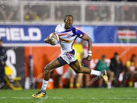 USA player Perry Baker breaks away to score a try in the game USA vs Australia  during the USA Sevens Rugby Series at Sam Boyd Stadium, Las Vegas. Picture by Ian  Muir