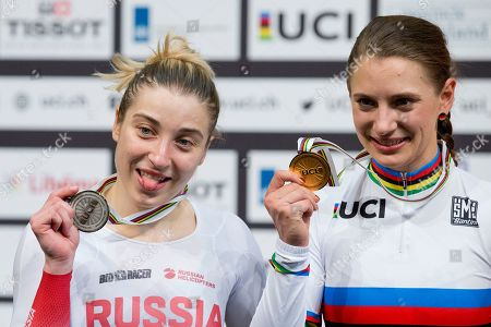 World champion Miriam Welte of Germany, center, and silver medalist Daria Shmeleva of Russia, left, pose with their medals on the podium of the women's 500 meters time trial final at the World Championships Track Cycling in Apeldoorn, eastern Netherlands, Netherlands