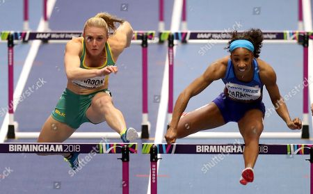 Australia's Sally Pearson, left, and United States' Kendra Harrison, right, compete during a women's 60 meter hurdles semi-final at the World Athletics Indoor Championships in Birmingham, Britain