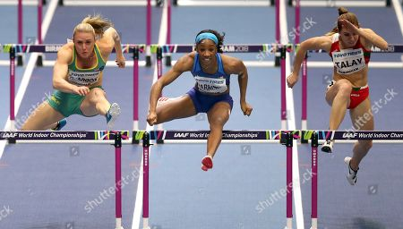 Australia's Sally Pearson, left, United States' Kendra Harrison, center, and Belarus' Alina Talay, right, compete during a women's 60 meter hurdles semi-final at the World Athletics Indoor Championships in Birmingham, Britain