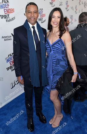 Stock Image of Cary Grant Jr., Dana Au. Cary Grant Jr., left, and Dana Au arrive at the 33rd Film Independent Spirit Awards, in Santa Monica, Calif