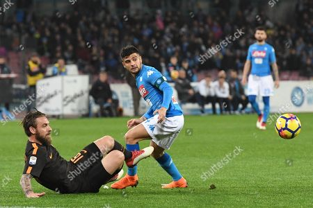 Napoli's forward Lorenzo Insigne (R) and Roma's midfielder Daniele De Rossi in action during the Italian Serie A soccer match between SSC Napoli and AS Roma  at the San Paolo stadium in Naples, Italy, 03 March 2018.