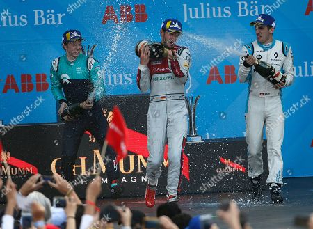 Sebastien Buemi, Oliver Turvey, Daniel Abt. Second place winner Nio driver Oliver Turvey, left, and third place winner Renault driver Sebastien Buemi, spray champagne at champion Daniel Abt, of Audi Sport ABT Schaeffler, as they celebrate at the end of the Formula E Mexico City ePrix auto race
