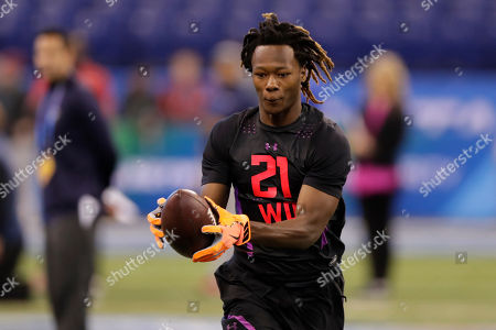 Washington State wide receiver Tj Martin runs a drill at the NFL football scouting combine in Indianapolis