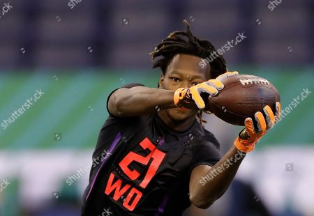 Washington State wide receiver Tj Martin runs a drill at the NFL football scouting combine, in Indianapolis