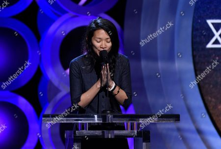 Chloe Zhao accepts the Bonnie award at the 33rd Film Independent Spirit Awards, in Santa Monica, Calif
