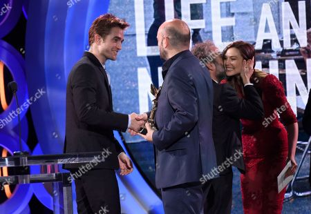 "Antonio Mendez Esparza, Pedro Hernandez Santos, Robert Pattinson, Elizabeth Olsen. Antonio Mendez Esparza, second from left, and Pedro Hernandez Santos, third from left, accepts the John Cassavetes award for ""Life and Nothing More"" from Robert Pattinson, far left, and Elizabeth Olsen, far right, at the 33rd Film Independent Spirit Awards, in Santa Monica, Calif"