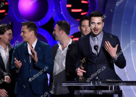 """Matt Spicer accepts the award for best first feature for """"Ingrid Goes West"""" at the 33rd Film Independent Spirit Awards, in Santa Monica, Calif"""