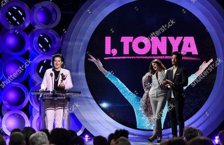 "Tatiana S. Riegel, John Cho, Kathryn Hahn. Tatiana S. Riegel accepts the award for best editing for ""I, Tonya"" at the 33rd Film Independent Spirit Awards, in Santa Monica, Calif. John Cho, right, and Kathryn Hahn look on"