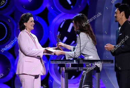 "Tatiana S. Riegel, Kathryn Hahn, John Cho. Tatiana S. Riegel, left, accepts the award for best editing for ""I, Tonya"" from Kathryn Hahn and John Cho at the 33rd Film Independent Spirit Awards, in Santa Monica, Calif"