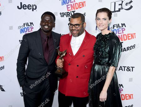 """Daniel Kaluuya, Jordan Peele, Allison Williams. Daniel Kaluuya, from left, Jordan Peele, and Allison Williams pose in the press room with the award for best feature for """"Get Out"""" at the 33rd Film Independent Spirit Awards, in Santa Monica, Calif"""