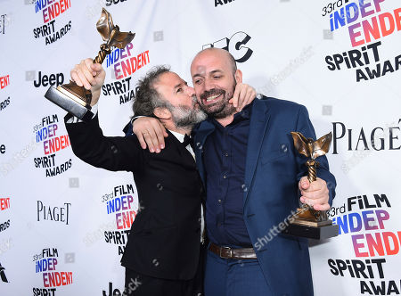 "Antonio Mendez Esparza, Pedro Hernandez Santos. Pedro Hernandez Santos, left, and Antonio Mendez Esparza pose in the press room with their John Cassavetes award for ""Life and Nothing More"" at the 33rd Film Independent Spirit Awards, in Santa Monica, Calif"