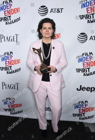 """Tatiana S. Riegel poses in the press room with the award for best editing for """"I, Tonya"""" at the 33rd Film Independent Spirit Awards, in Santa Monica, Calif"""