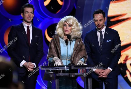 Stock Image of Kriste Wiig, John Mulaney, Nick Kroll. Kristen Wiig, center, portrays Fay Fontaine, during a comedy skit with hosts John Mulaney, left, and Nick Kroll at the 33rd Film Independent Spirit Awards, in Santa Monica, Calif