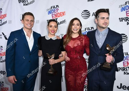 """Billy Magnussen, Aubrey Plaza, Elizabeth Olsen, Matt Spicer. Billy Magnussen, from left, Aubrey Plaza, Elizabeth Olsen, and Matt Spicer pose in the press room with the award for best first feature for """"Ingrid Goes West"""" at the 33rd Film Independent Spirit Awards, in Santa Monica, Calif"""