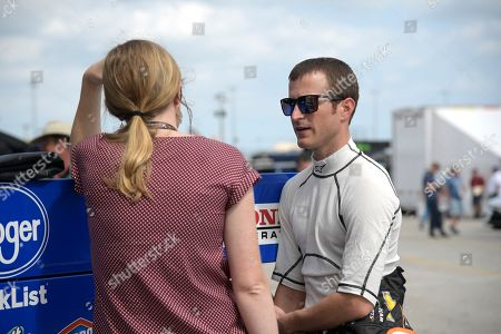 Kasey Kahne, right, talks in the garage area during practice for the Daytona 500 at Daytona International Speedway, in Daytona Beach, Fla