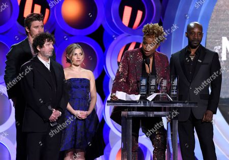 """Dee Rees, Garrett Hedlund, Billy Hopkins, Ashley Ingram, Rob Morgan. Dee Rees, second from right, accepts the Robert Altman award for """"Mudbound"""" at the 33rd Film Independent Spirit Awards, in Santa Monica, Calif. Looking on from far left are Garrett Hedlund, Billy Hopkins, Ashley Ingram and Rob Morgan"""