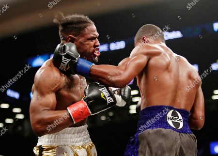 Patrick Day, Kyrone Davis. Patrick Day, right, punches Kyrone Davis during the third round of a WBC super welterweight championship boxing match, in New York. Day won the bout