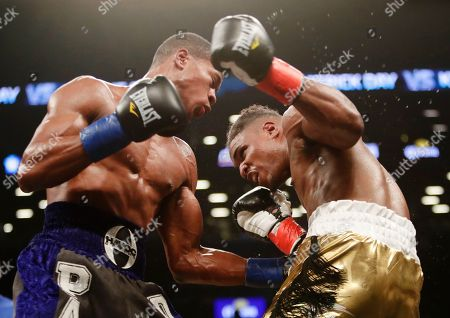 Patrick Day, Kyrone Davis. Patrick Day, left, punches Kyrone Davis during the ninth round of a WBC super welterweight championship boxing match, in New York. Day won the bout