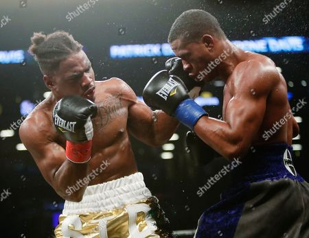 Patrick Day, Kyrone Davis. Kyrone Davis, left, punches Patrick Day during the eighth round of a WBC super welterweight championship boxing match, in New York. Day won the bout