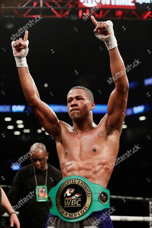 Patrick Day, Kyrone Davis. Patrick Day celebrates after defeating Kyrone Davis in a WBC super welterweight championship boxing match, in New York