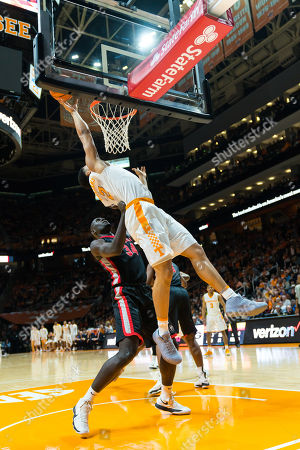 Grant Williams #2 of the Tennessee Volunteers tries to shoot the ball while Derek Ogbeide #34 of the Georgia Bulldogs defends during the NCAA basketball game between the University of Tennessee Volunteers and the University of Georgia Bulldogs at Thompson Boling Arena in Knoxville TN Tim Gangloff/CSM