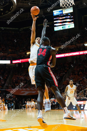 Grant Williams #2 of the Tennessee Volunteers shoots the ball over Derek Ogbeide #34 of the Georgia Bulldogs during the NCAA basketball game between the University of Tennessee Volunteers and the University of Georgia Bulldogs at Thompson Boling Arena in Knoxville TN Tim Gangloff/CSM