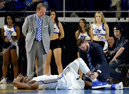 Brandon Walters, Kermit Davis. Middle Tennessee forward Brandon Walters, bottom, is attended to after being injured during the second half of an NCAA college basketball game against Marshall, in Murfreesboro, Tenn. Middle Tennessee head coach Kermit Davis, left, watches. Marshall won 76-67