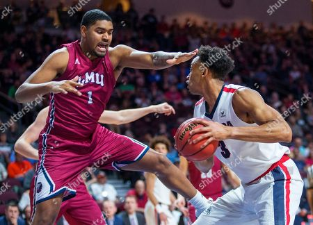 Loyola Marymount's Zafir Williams (1) defends against Gonzaga's Johnathan Williams (3) during the second half of an NCAA college basketball game in the quarterfinals of the West Coast Conference men's tournament, in Las Vegas