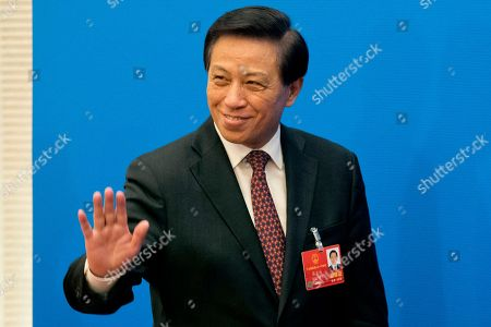 Zhang Yesui, a spokesman for the National People's Congress, arrive for a press conference on the eve of the annual legislature opening session at the Great Hall of the People in Beijing