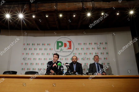 Maurizio Martina, Matteo Orfini, Lorenzo Guerini. Democratic Party lawmakers, from left, Maurizio Martina, Matteo Orfini and Lorenzo Guerini talk to journalists in the party's headquarters, in Rome, . More than 46 million Italians voted Sunday in a general election that is being closely watched to determine if Italy would succumb to the populist, anti-establishment and far-right sentiment that has swept through much of Europe in recent years