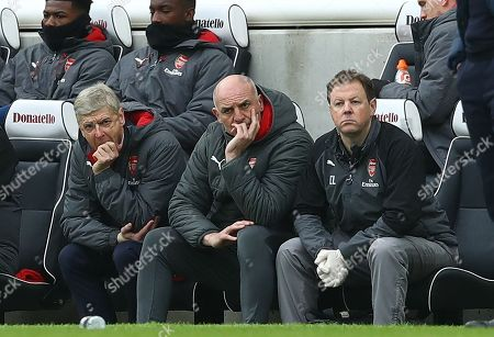 Arsene Wenger manager of Arsenal with Steve Bould and Colin Lewin watch the match