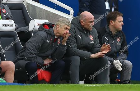 Arsene Wenger manager of Arsenal with Steve Bould and Colin Lewin watching the match