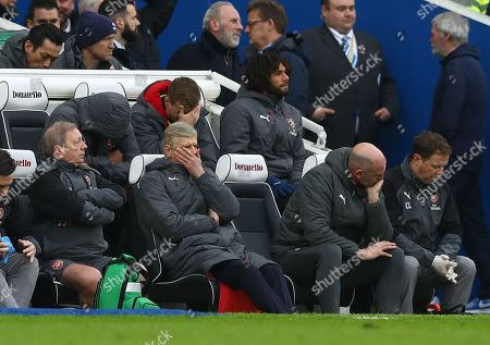 Arsene Wenger manager of Arsenal with Steve Bould and Colin Lewin dejected