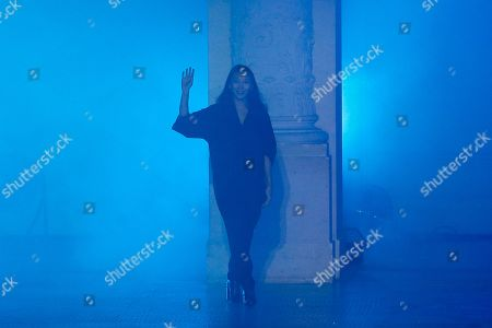 Stock Photo of Beijing-born designer Yiqing Yin acknowledges applause after the presentation of Poiret ready-to-wear fall/winter 2018/2019 fashion collection presented in Paris