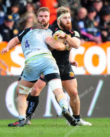 Luke Cowan-Dickie of Exeter Chiefs is tackled by Dominic Day of Saracens during the Aviva Premiership match between Exeter Chiefs and Saracens at Sandy Park on March 4th 2018, Exeter, Devon (