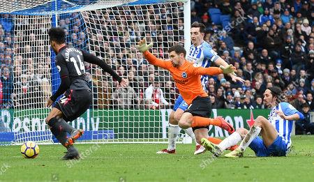 Pierre-Emerick Aubameyang, of Arsenal rounds Matthew Ryan,  Lewis Dunk and Matias Ezequiel Schelotto of Brighton but fails to score.
