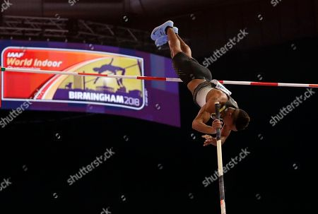 Germany's Raphael Holzdeppe makes an attempt in the men's pole vault final at the World Athletics Indoor Championships in Birmingham, Britain