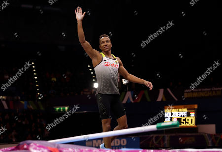 Germany's Raphael Holzdeppe waves after an attempt in the men's pole vault final at the World Athletics Indoor Championships in Birmingham, Britain