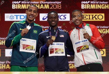 Silver medalist Brazil's Almir Dos Santos, gold medalist United States' Will Claye and Portugal's Nelson Evora, from left to right, pose with their medals won in the men's triple jump at the World Athletics Indoor Championships in Birmingham, Britain
