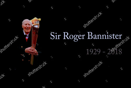 A video screen shows a tribute to Roger Bannister at the World Athletics Indoor Championships in Birmingham, Britain, . Bannister, the first person to run a mile in under four minutes, died March 3