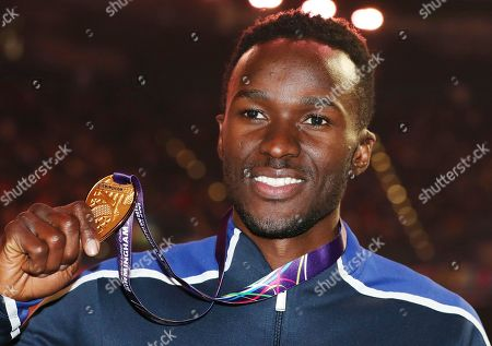 United States' Will Claye shows off his gold medal after the ceremony for the men's triple jump at the World Athletics Indoor Championships in Birmingham, Britain