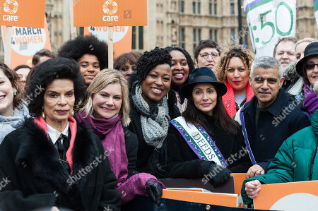 Stock Image of (L-R) Bianca Jagger, Justine Greening, Shola Mos-Shogbamimu, Dawn Butler, Natalie Imbruglia, Salena Godden and Mayor of London Sadiq Khan gather at Old Palace Yard outside the Houses of Parliament in London to take part in March4Women