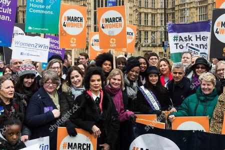 (CL-R) Bianca Jagger, Justine Greening, Shola Mos-Shogbamimu, Dawn Butler, Natalie Imbruglia, Salena Godden, Mayor of London Sadiq Khan, Helen Pankhurst and Sandi Toksvig gather at Old Palace Yard outside the Houses of Parliament in London to take part in March4Women