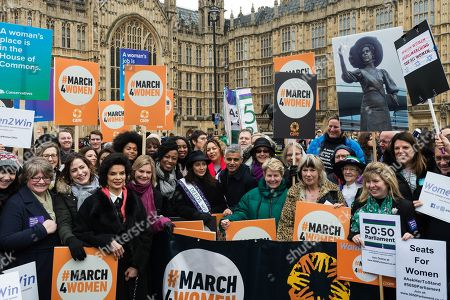 Stock Picture of (3L-R) Bianca Jagger, Justine Greening, Shola Mos-Shogbamimu, Dawn Butler, Natalie Imbruglia, Salena Godden, Mayor of London Sadiq Khan, Helen Pankhurst, Sandi Toksvig, Jude Kelly and Caroline Nokes gather at Old Palace Yard outside the Houses of Parliament in London to take part in March4Women