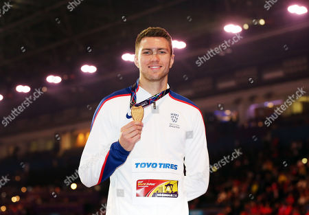 Andrew Pozzi of Great Britain poses with his gold medal won in the Mens 60m Hurdles Final.