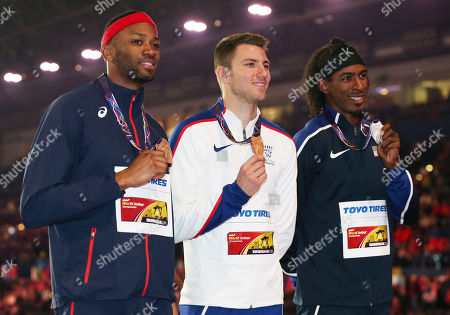 Andrew Pozzi of Great Britain poses with his gold medal won in the Mens 60m Hurdles Final alongside silver medalist Jarrett Eaton of USA and bronze medalist Aurel Manga of France.